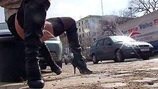 Red haired Hungarian babe peeing on public sidewalk with all the people around watching her bald beaver leaking